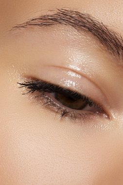 Healthcare and cosmetics. Part of female face. Closeup of woman's eye with natural makeup. Moisturizing gel on eyelid