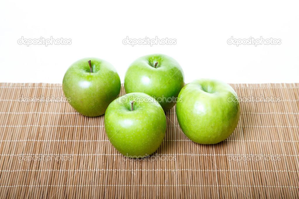 four green apples on bamboo mat stock photo dbvirago 27394177