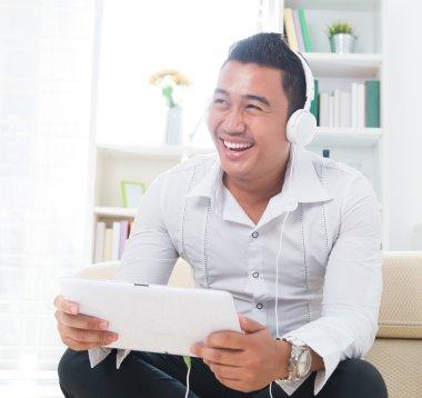Asian man listen music with headphone