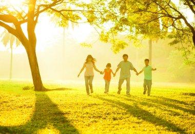 Asian family holding hands running