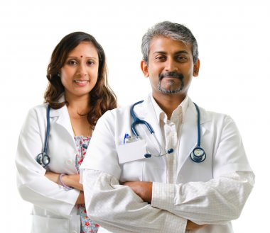 Indian doctors or medical team crossed arms standing isolated on white background stock vector