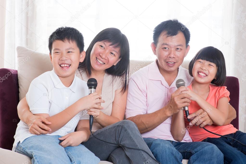 Asian family singing karaoke — Stock Photo © szefei #21248331