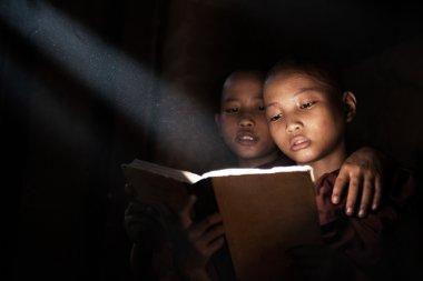 Little monks reading book