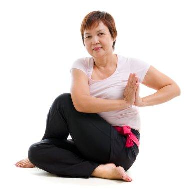 Asian senior woman practicing yoga