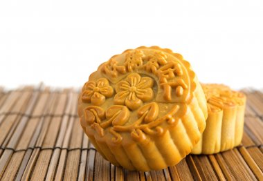 Traditional mooncakes on bamboo mat
