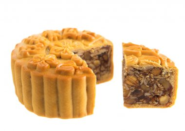 Isolated assorted fruits nuts mooncakes