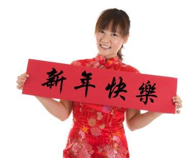 Chinese cheongsam woman holding couplet