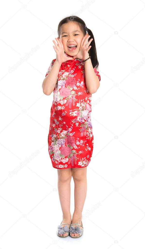 4e0ebd410f7fc Full length China girl in traditional Chinese cheongsam dress shouting  Happy Chinese New Year to everyone, standing isolated on white background —  Photo by ...