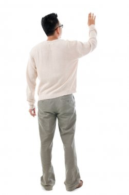 Rear view Asian man touching on transparent virtual screen