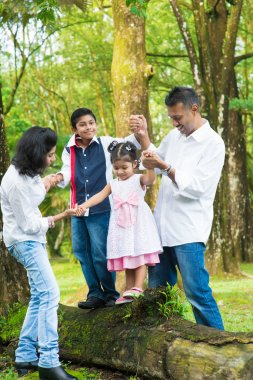 Happy Indian family outdoor fun