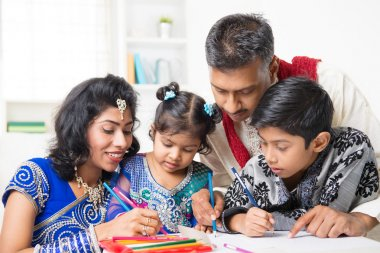 Indian family painting picture at home