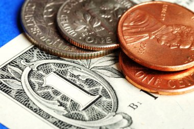Coins and dollar bill concepts of money investing and wealth