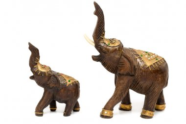 Two wooden statues of elephants