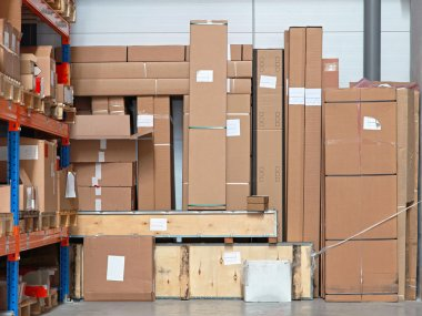 Cardboard boxes with equipment in distribution warehouse stock vector