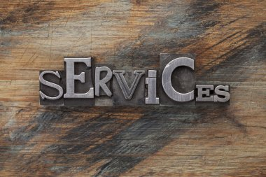 Services - word in vintage letterpress metal type blocks on a grunge painted wood stock vector