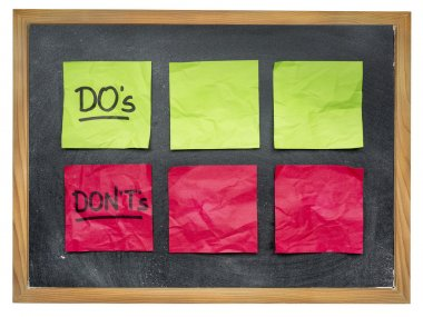 Do's and don't's - things to do and not -  blank sticky notes on on blackboard stock vector