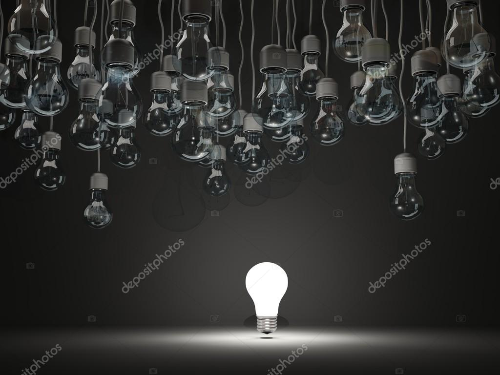 Bright light bulb on black background