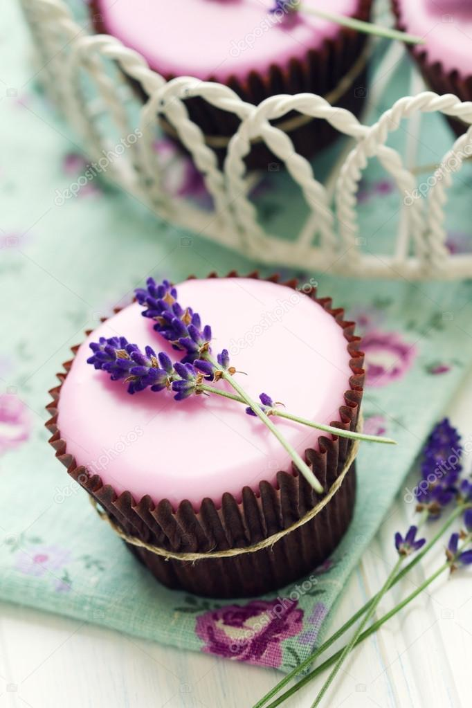 Summer cupcakes decorated with lavender frosting