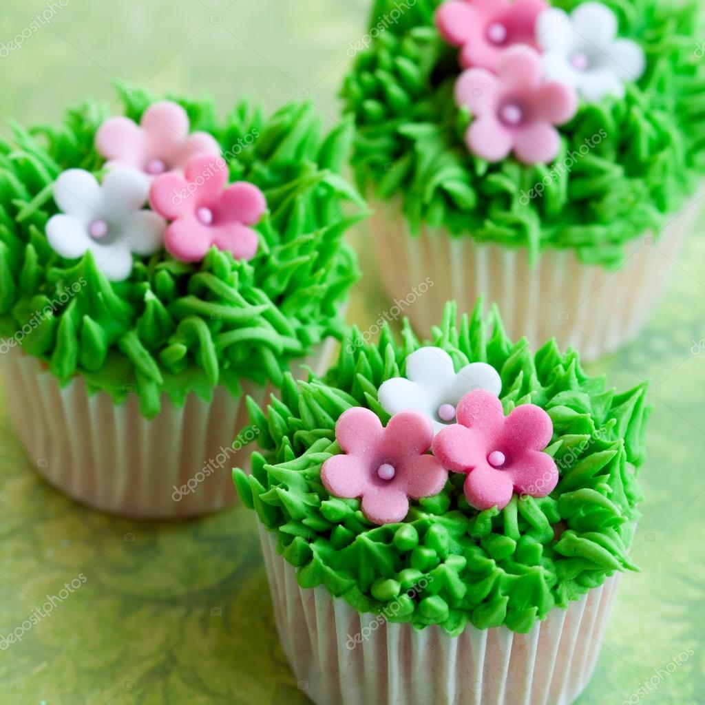 Cupcakes Decorated With Pink And White Flowers Photo By