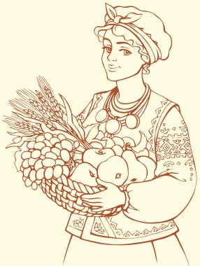Beautiful girl in Ukrainian costume with basket of autumn fruits