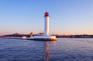 Operating lighthouse in Odessa in the evening. Ukraine. Black se