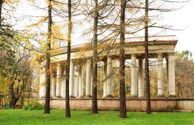 Colonnade of the old-time estate among the autumn trees