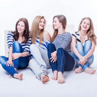 Group of four beautiful young happy women