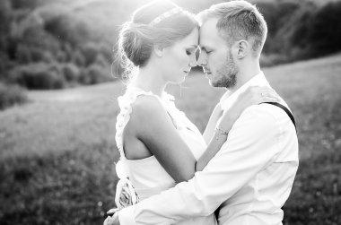 Emotional wedding moment. Bride and groom embrace.