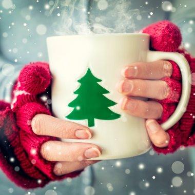 Girl drinking hot coffee