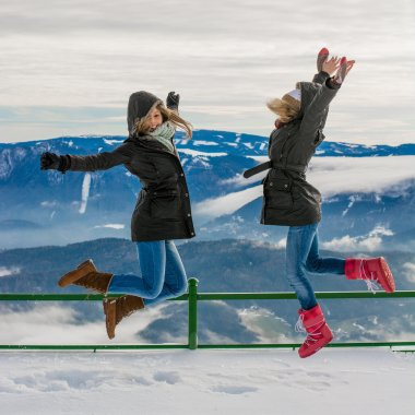 Winter vacation, friends jumping
