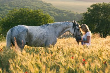Beautiful girl and horse outdoors