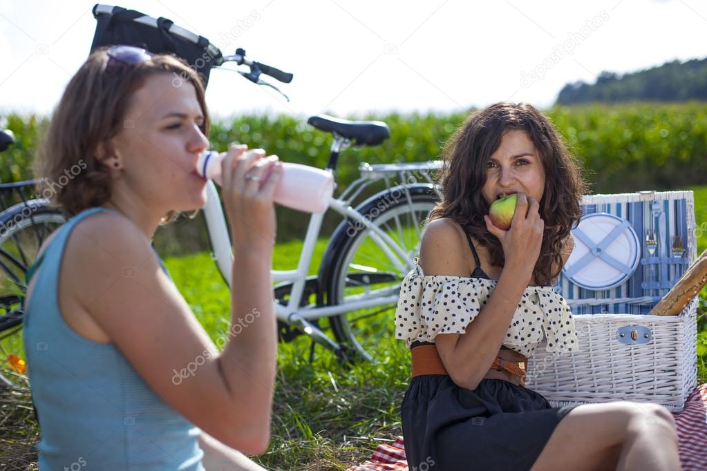 Two pretty girls make a picnic