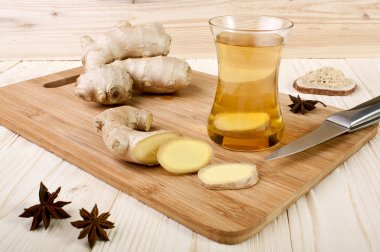 Ginger tea on a wooden background