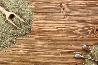 Background - yerba mate and bombilla on a wooden table