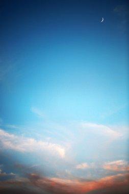 Beautiful sunset , deep blue sky and moon