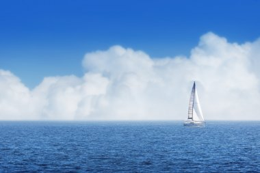 Sailing ship yachts with white sails and cloudy sky