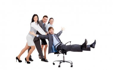 Excited Business people push colleague sitting in chair