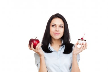 Woman hold piece of cake and red apple