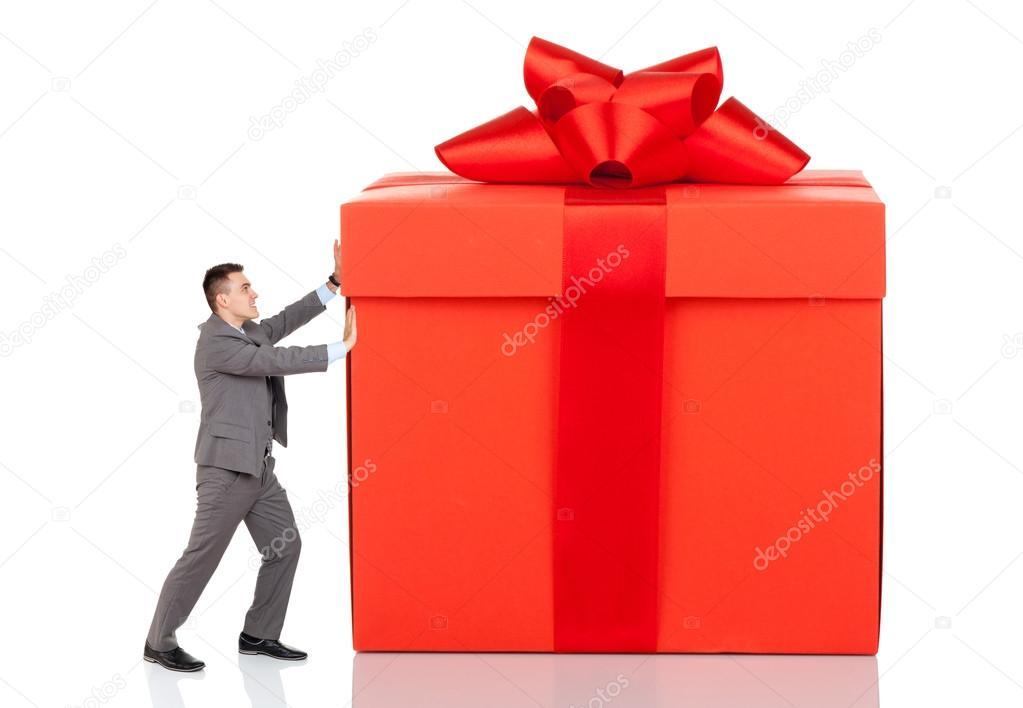 Businessman push big gift box