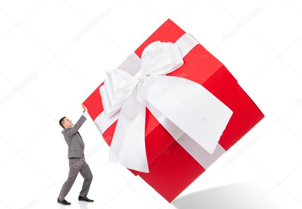 businessman push big gift box stock photo mast3r 31739935