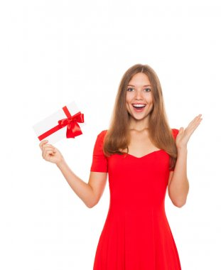 Holiday girl with happy smile holding red gift card