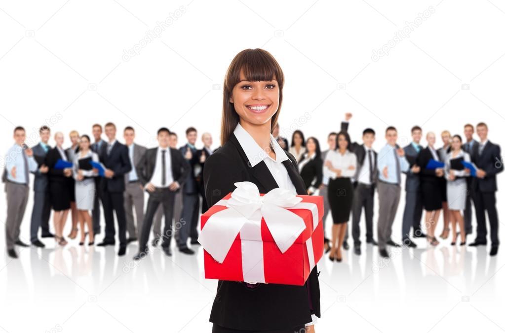 Businesswoman holding present in hand