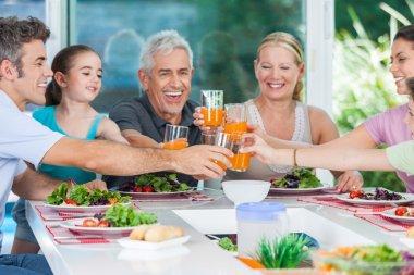 Big generation family drink orange juice