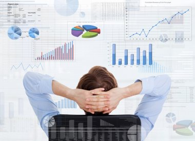 Businessman looking at financial diagrams