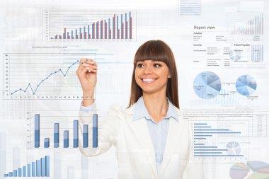 Business woman drawing finance chart