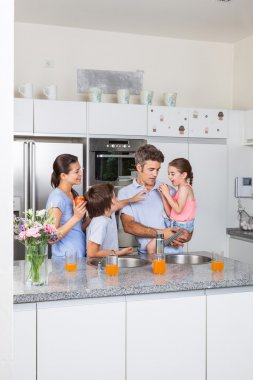 Family in modern kitchen
