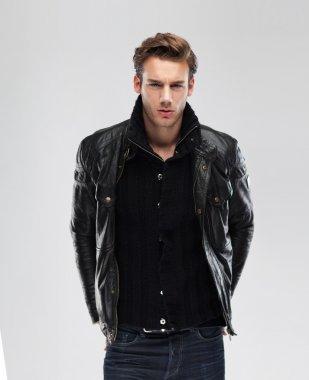 Serious man wearing leather jacket