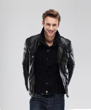 Smiling man wearing leather jacket