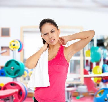 Fitness woman feels neck pain