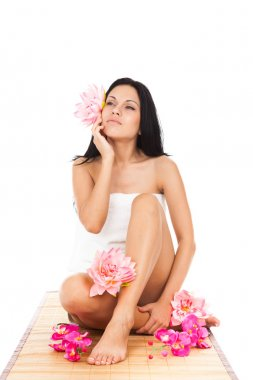 Beautiful spa woman with flowers